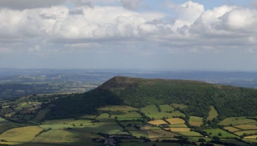 PARAGLIDING AROUND THE SUGAR LOAF PEAK IN THE BLACK MOUNTAINS, WALES