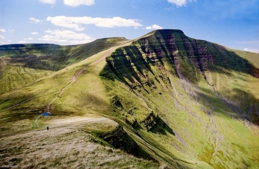 REACHING THE SUMMIT OF PEN Y FAN IN THE BRECON BEACONS NATIONAL PARK, WALES