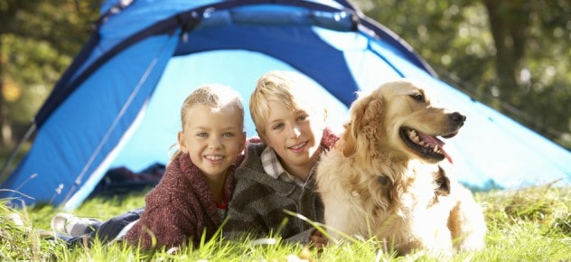 young children camping with dog